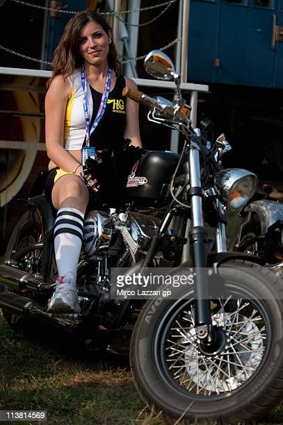 A grid girl poses on bike in paddock during the free practice of Superbike World Championship Round Four in Monza Circuit on May 6 2011 in Monza Italy