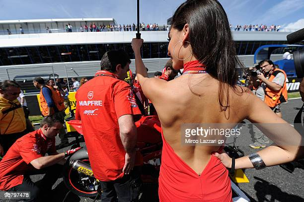 A grid girl poses on the grid at the start of the 125 cc race at Circuito de Jerez on May 2 2010 in Jerez de la Frontera Spain