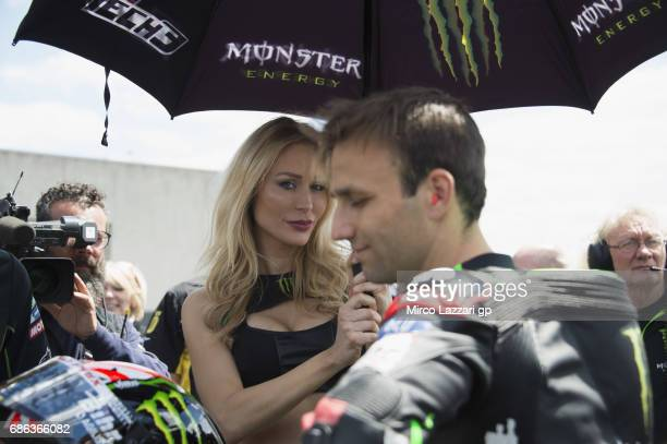 A grid girl poses on the grid during the MotoGP riders during the MotoGp of France Race on May 21 2017 in Le Mans France