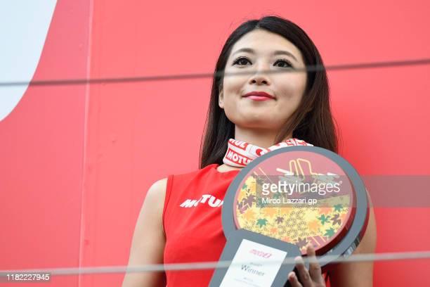 Grid girl smiles on podium during the MotoGP of Japan - Race at Twin Ring Motegi on October 20, 2019 in Motegi, Japan.