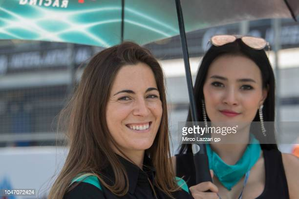 A grid girl smiles on the grid during the Moto2 race during the MotoGP Of Thailand Race on October 7 2018 in Buri Ram Thailand