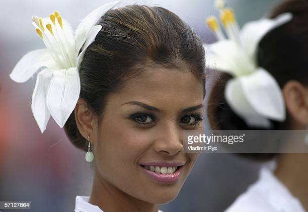 A grid girl smiles prior to the Malaysian Formula One Grand Prix on March 19 in Kuala Lumpur Malaysia