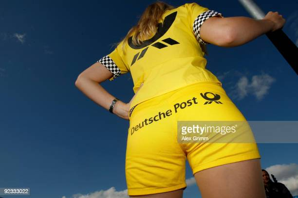 Grid girl waits for the start of the final run of the DTM 2009 German Touring Car Championship at the Hockenheim race track on October 25 2009 in...