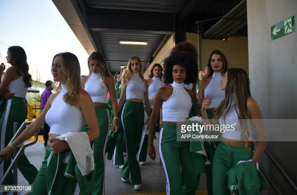 Grid girls are pictured during the Brazilian Formula One Grand Prix at the Interlagos circuit in Sao Paulo Brazil on November 12 2017 / AFP PHOTO /...