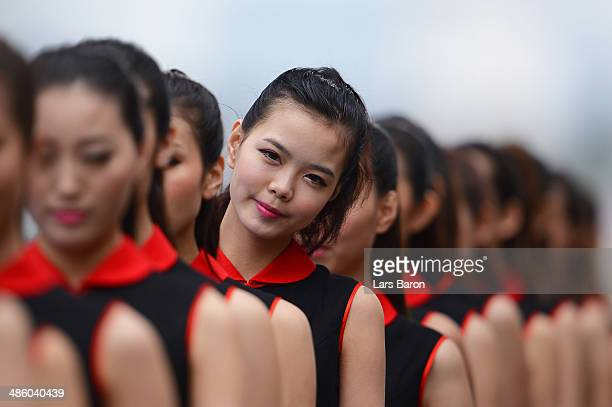 Grid girls are pictured prior to the Chinese Formula One Grand Prix at the Shanghai International Circuit on April 20 2014 in Shanghai China