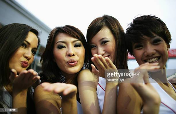 Grid girls are seen before the Singapore Formula One Grand Prix at the Marina Bay Street Circuit on September 27 2009 in Singapore