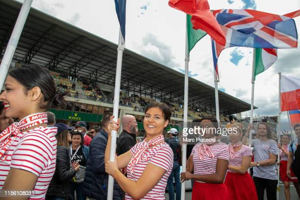Grid girls attend the 24 Hours of Le Mans race on June 15, 2019 in Le Mans, France.