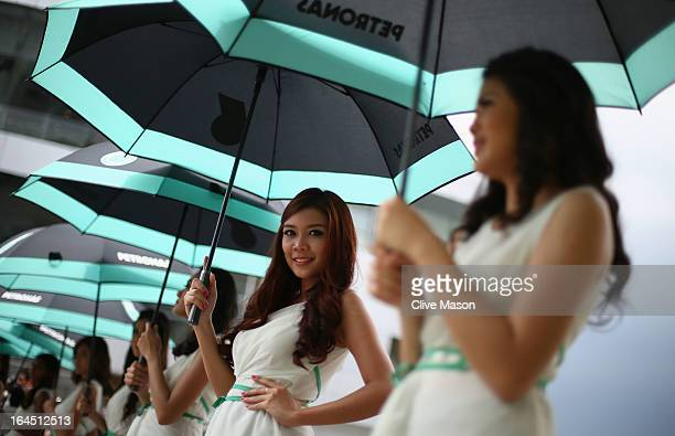 Grid girls line up for the drivers parade before the Malaysian Formula One Grand Prix at the Sepang Circuit on March 24 2013 in Kuala Lumpur Malaysia