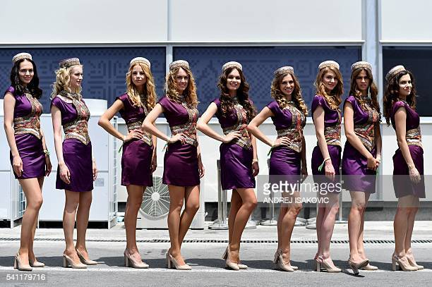 Grid girls pose at the Baku City Circuit on June 19 2016 in Baku ahead of the European Formula One Grand Prix / AFP / ANDREJ ISAKOVIC
