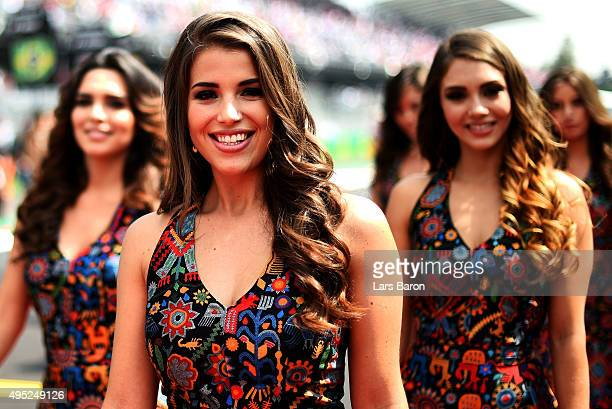 Grid girls pose during the drivers' parade ahead of the Formula One Grand Prix of Mexico at Autodromo Hermanos Rodriguez on November 1 2015 in Mexico...
