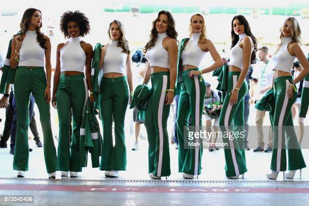 Grid girls pose for a photo before the Formula One Grand Prix of Brazil at Autodromo Jose Carlos Pace on November 12 2017 in Sao Paulo Brazil