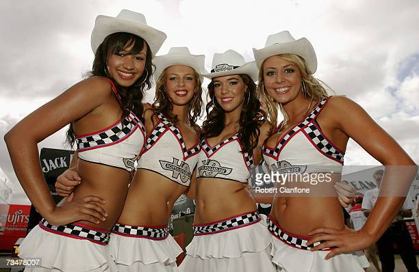 Grid girls pose for a photograph prior to race one of the Clipsal 500 V8 Supercars on the Adelaide Street Circuit on March 3 2007 in Adelaide...