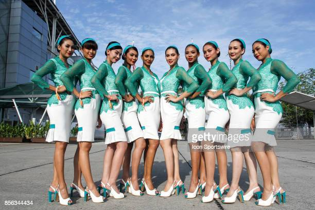 Grid girls pose for photograph before the start of the race of the Formula 1 Petronas Malaysia Grand Prix held at Sepang International Circuit in...