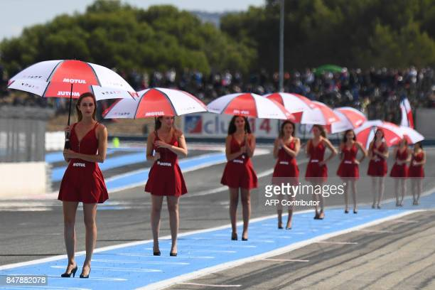 Grid girls pose for photographers at the beginning of the 81st Bol d'Or 24hour motorbike race on September 16 at the Paul Ricard racetrack in Le...