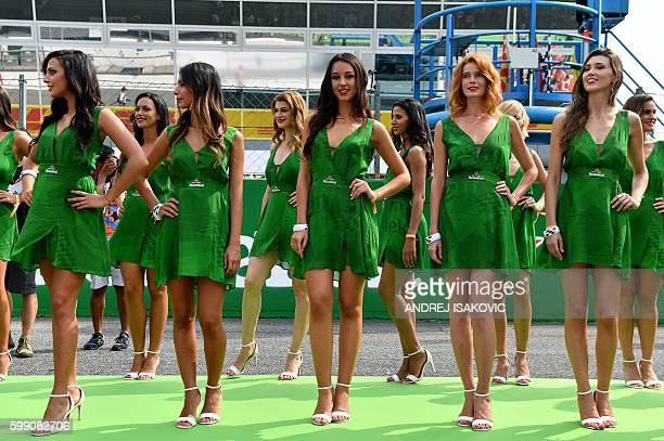Grid girls pose for pictures ahead of the Italian Formula One Grand Prix at the Autodromo Nazionale circuit in Monza on September 4 2016 / AFP /...
