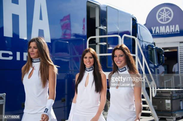 Grid girls walk intp the paddock before the official presentation of the Yamaha Factory Team during the MotoGP Tests In Jerez at Circuito de Jerez on...