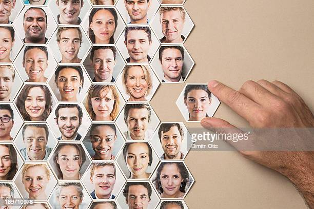 grid of hexagonal portraits, hand adding new one - diagramma di flusso foto e immagini stock
