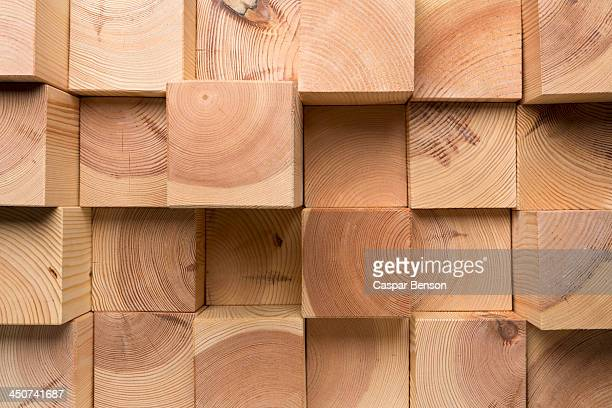 A grid of wooden blocks arranged in varying lengths