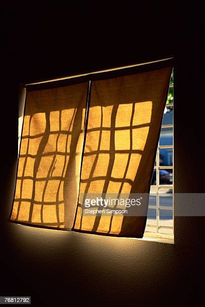 Grid shadows on window curtains