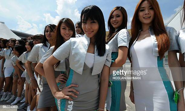 Gridgirls pose for photographers prior to the third practice session for Formula One's Malaysian Grand Prix in Sepang on April 2 2010 AFP...