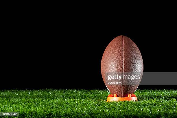 gridiron ball standing on a tee - tee sports equipment stock photos and pictures