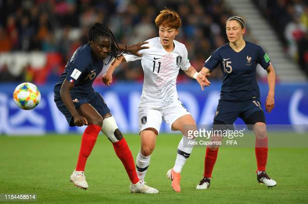 Griedge Mbock Bathy and Elise Bussaglia of France battle for possession with Seolbin Jung of Korea Republic during the 2019 FIFA Women's World Cup...