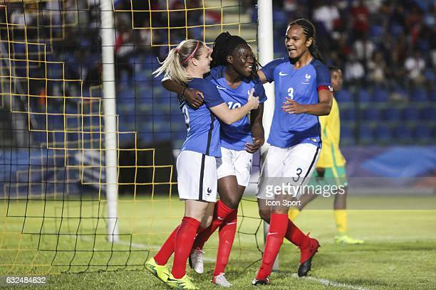 Griedge MBock Bathy of France celebrates scoring with Eugenie Le Sommer and Wendie Renard during the Women's International Friendly match between...