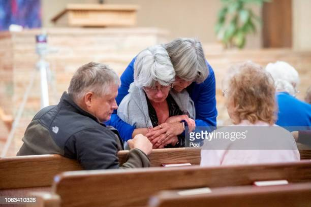 A grief counselor hugs Dorothy Carini during a vigil for Camp Fire victims at the First Christian Church of Chico on November 18 2018 in Chico...
