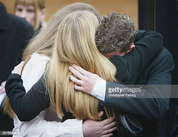 Grief stricken friends and family attend the funeral of murdered Scottish teenager Kriss Donald takes place at The Church Jesus Christ of Latter Day...