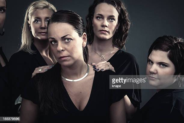 grief - women getting together to console - clique stock photos and pictures