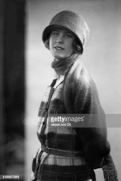 Grieger Claire Actress Germany wearing a checked cardigan with stole and hat 1924 Photographer Suse Byk Published by 'Die Dame' 10/1924 Vintage...