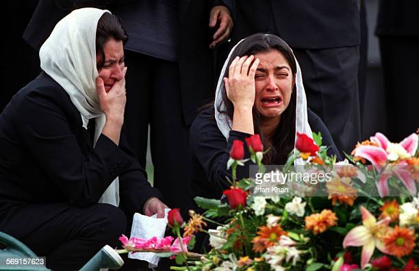 Grieving at the burial site of Singapore airlines crash victim Fuad Memon of Aliso Viejo are from left mother–in–law Amena Yakub and wife Freba Memon...