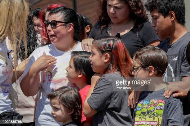 Grieving family members weep as pallbearers bring out the casket of 10yearold Anthony Avalos after funeral services held at Saint Junipero Serra...