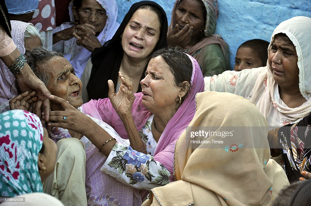 Grieving family of Shakeel who allegedly died last night after police beating at Kavi Nagar police station area on June 15, 2013 in Ghaziabad, India.