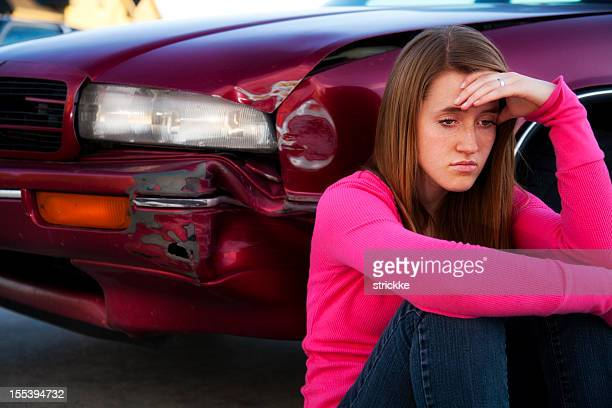 Grieving Female Teenager Contemplates Fender Bender