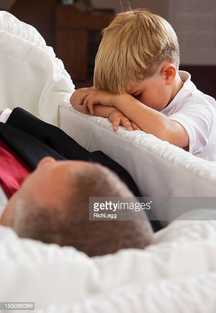 grieving little boy - open casket stock pictures, royalty-free photos & images