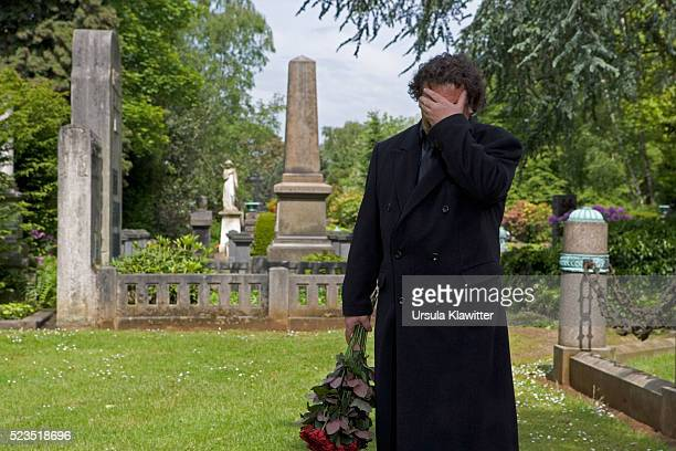 Grieving Man in Cemetery
