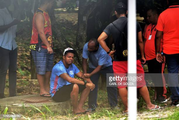 Grieving man is seen at Brazilian football club Flamengo training center after it caught fire in Vargem Grande neighborhood, west of Rio de Janeiro,...