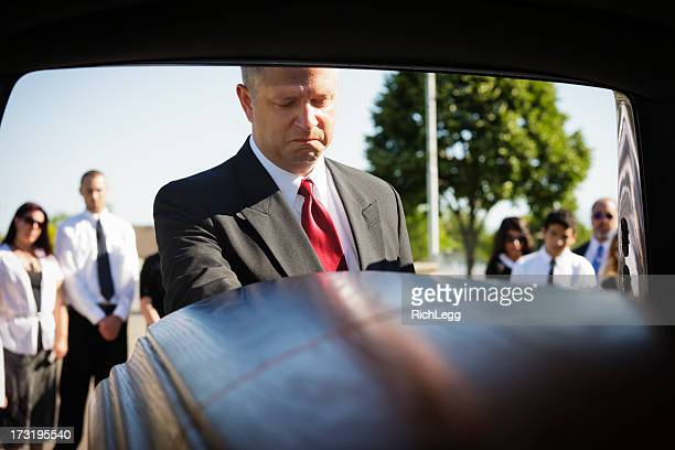 grieving man - hearse stock photos and pictures