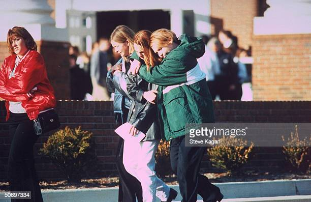 Grieving Paduach HS students after freshman Michael Carneal killed 3 of their classmates incl Nicole Hadley Jessica James Kacey Steger wounded 5...