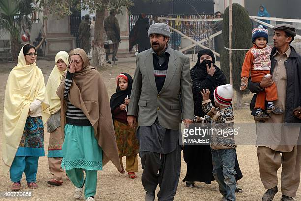 A grieving Pakistani family departs an armyrun school in Peshawar on December 22 where their family member Ali was killed during the December 16...