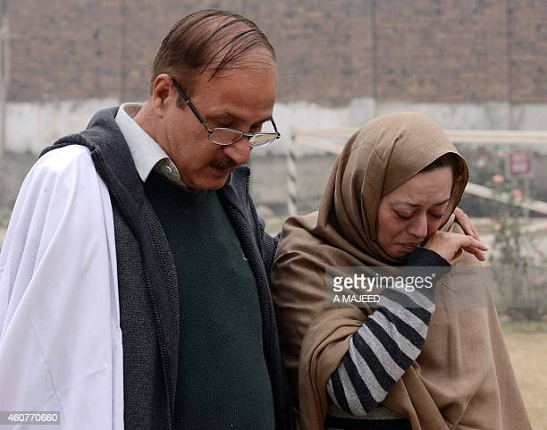 Grieving Pakistani parents depart an armyrun school in Peshawar on December 22 where their child Ali was killed during the December 16 massacre by...