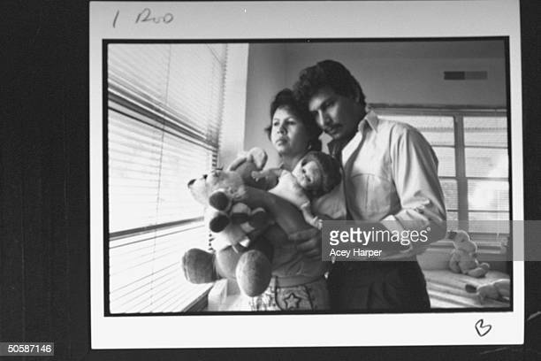 Grieving parents Ramiro Carmen Rodriguez holding stuffed animals doll of their late 3yrold daughter Veronica who died in fatherdriven car crash...