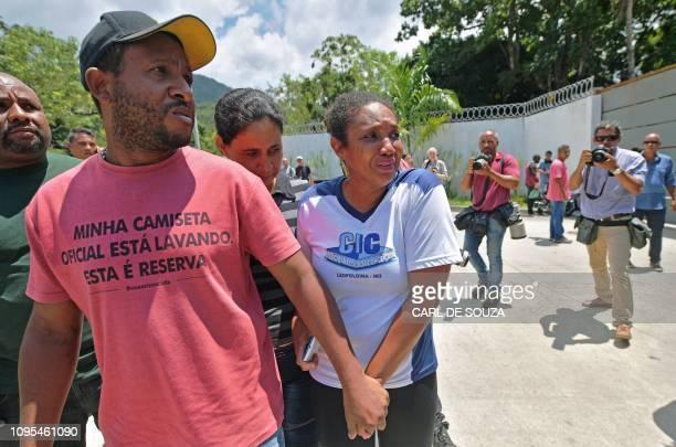 Grieving relatives arrive at Brazilian football club Flamengo training center after it caught fire in Vargem Grande neighborhood, west of Rio de...