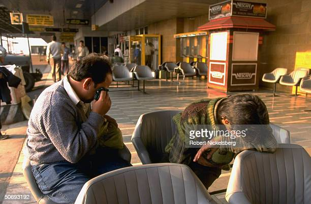 Grieving relatives of passengers awaiting news at airport after Saudi Arabian Airlines Boeing 747 passenger jet Kazakh KazAir Ilyushin76 cargo planes...