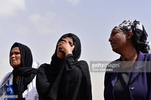 Grieving relatives of the victims react as they arrive at the crash site of the Ethiopian Airlines operated Boeing 737 MAX aircraft at Hama...