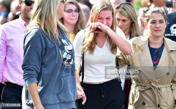 TOPSHOT Grieving students from Saugus High School reunite with their parents at Central Park in Santa Clarita California on November 14 2019 A...
