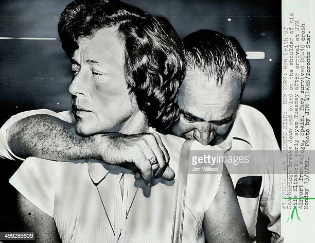 Grieving survivors Shocked and still bewildered as he arrives in New York on his way home crash survivor Ron Leith weeps on wife Elizabeth s shoulder...