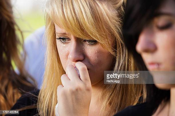 grieving teenage girl - funeral stock pictures, royalty-free photos & images