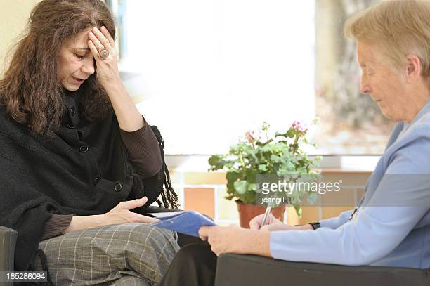 Grieving woman speaking to a therapist